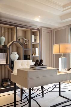 Love these neutrals together with the architectural details. I love the bookcase shapes..