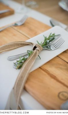 a sprig of rosemary tied with a burlap ribbon... chic and simple