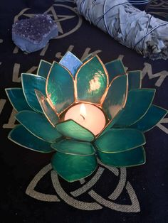 "Stunning lotus votive tea light holders made with real capiz shell. Add a luminous and delicate touch to your home. 5 1/2"" x 2.5"""