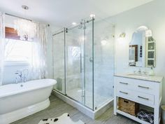 Freestanding bathtub, capiz shell chandelier and marble tiling from Redbud Construction Services