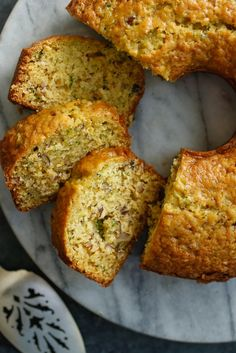 NYT Cooking: This extraordinary cake is a sophisticated riff on the ubiquitous zucchini bread. It's more delicate and tender than the classic loaf, fresh ginger and orange zest add a dash of vibrancy, and hazelnuts add crunch. It's also blissfully simple to make. Just two bowls, a wooden spoon and a tube (or bundt) pan and you're on your way.