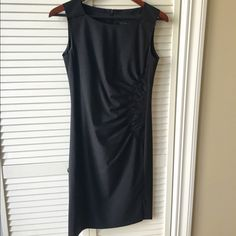 ❤️REDUCED❤️ Boss Hugo Boss Black Dress This spectacular dress is very detailed.  The dress has a small slit just above the left knee. It has a back zip.  The shoulders and left waist  have beautiful  stitching.  It is a size 0. The dress was worn once. The fabric is 96% wool and 4% elastane. Hugo Boss Dresses Mini