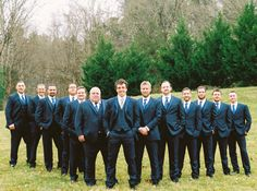 Formal groomsmen outfit idea - black tuxedos with blue striped neckties {JOPHOTO}