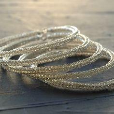 Sterling silver bangle bracelets , three 3 bangles, wire crochet door Yoola op Etsy https://www.etsy.com/nl/listing/54419442/sterling-silver-bangle-bracelets-three-3