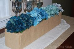 Bridal Shower Idea - Ombre Shades of Blue Centerpiece (using Mason jars lined up in a row instead of the container pictured)