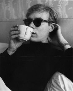 Andy Warhol drinking coffee.