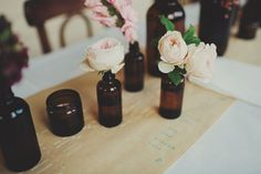 roses in simple amber bottles // photo by Jonathan Ong