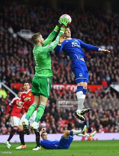 Goalkeeper David De Gea of Manchester United claims the ball from John Stones of Everton during the Barclays Premier League match between Manchester United and Everton at Old Trafford on April 3, 2016 in Manchester, England.