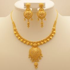 This Necklace Set is made in 22 Carat Indian Gold. All our designs are unique and manufactured to the highest quality by our skilled craftsmen. Contact us if you require more information on this product. Gold Earrings Designs, Gold Jewellery Design, Necklace Designs, Gold Jewelry, Gold Designs, Pearl Jewelry, Simple Necklace, Necklace Set, Bridal Necklace