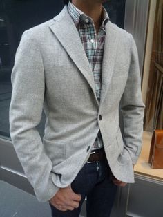 Lt. Grey jacket, blue & brown plaid shirt, brown belt and dark wash jeans