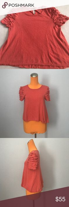 "Knitted & Knotted Petite Coral Ruffle Sleeve Top 21"" length 18"" armpit to armpit. Is a petite fit. Has a keyhole in the back middle with a button closure. Ruffle detailing on the sleeves. Coral coloring. Crew neck short sleeve. Excellent condition. Bundle 2+ items for a discount Anthropologie Sweaters Crew & Scoop Necks"
