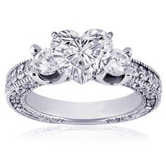 !!! I want this. diamonds all the way around the band and on the sides. The main diamond is in a heart