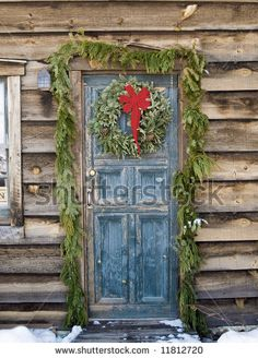Google Image Result for http://image.shutterstock.com/display_pic_with_logo/127273/127273,1208879027,4/stock-photo-christmas-wreath-on-a-rustic-door-of-a-log-cabin-11812720.jpg