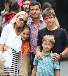 Picture perfect: Kelly Ripa and Mark Consuelos pose with their children, 14-year-old Joseph, 10-year-old Lola and eight-year-old Joaquin in ...