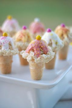 Kelloggs Rice Krispies Ice Cream Cones~ Rice krispy treats inside & the icing on top is candy melt or almond bark.