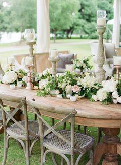 Rustic meets elegant floral covered tablescape: http://www.stylemepretty.com/2016/01/28/houston-oaks-country-club-wedding/ | Photography: Kelli Elizabeth - http://kellielizabeth.com/