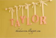 name wall hanging using a curtain rod- could do this with the p-h-i-m-u you get…
