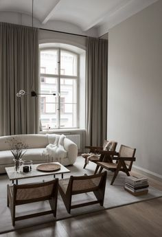 This stylish home from architect Andreas Martin Löf was styled by Lotta Agaton interiors for the third My Residence Magazine and I love the warm color palette. The dark brown furniture gives this home