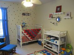 Baby boy nursery. Stars, rockets, red, black