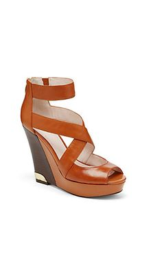 "WINDINI-We all like to be lifted up and the Windini by Vince Camuto can do just that. This towering wedge sandal has a thick front platform and a short back.zipper. Keep the rest of your outfit simple and let these shoes do the talking.  <li>4.5"" heel"
