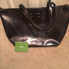 🚀 flash sale 🚀 Kate spade bag Bought this originally neon yellow Kate for 200ish. I then stained the front so I painted it black with leather paint. It has held up well with no transfer. The inside has some staining from the paint job. If looked up close on the straps, some yellow can be seen but it is not noticeable. Open to offers and trades. Comes with Kate care card. Only selling because I have too many Kate totes and need a Kate wallet. 💕 kate spade Bags Totes