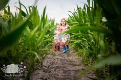 farm themed family photos in the corn, sisters racing down the rows. A 50's inspired photoshoot.
