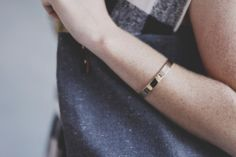 Go back to basics with this simple golden bracelet. $22