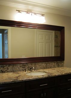 beautiful granite, custom cabinet and mirror, frameless glass shower, stone tub surround and shower - lovely