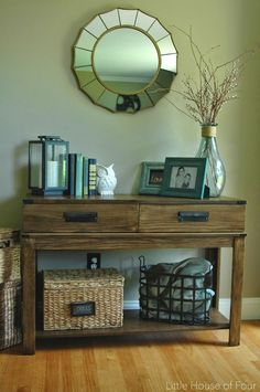 A HomeGoods table gets a West Elm inspired makeover with stain, metal accents and custom bin pulls.
