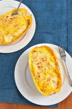 Skinny Spaghetti Squash Alfredo..  1 med sized spaghetti squash  1 tbsp butter  2½ tbsp flour  2-3 cloves of garlic, very finely minced  1 tbsp cream cheese(low fat is fine)  1½ C milk  1 C freshly grated Parmesan cheese, plus 2 tbsp extra for topping  ¼ tsp salt