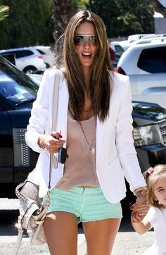 White jacket, mint denim shorts with neutral top.