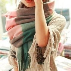 Add a pop of color with this long, wool & cotton blend, women's winter scarf. Plaid and print designs with many beautiful, rich color combinations. Solid colors also available. This is a must-have acc