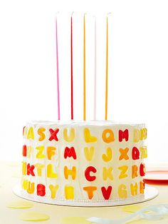 "A-B-Sweet Press gummy letters ($19 for a 5-lb. bag; amazon.com) into the frosting in colorful rows or spell out your child's name. Top your cake with giant 15"" tapers for a dramatic birthday wish. Birthday Cake Tapers, $28 for 12; oliveandcocoa.com"