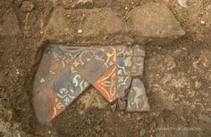 In situ tile floor possibly joining on to the rear wall of the choir near Richard III's grave.  Photo credit: University of Leicester