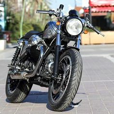 Italian Moto Guzzi guru Filippo Barbacane has just finished a new custom, 'Black Jack'. Simple and understated in silver and black, it's based on the 1000 SP—a somewhat ungainly tourer built between 1977 and 1985.
