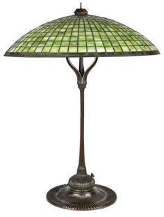 A Tiffany Studios leaded glass and bronze Parasol table lamp  1899-1918  brown green patina, has finial, shade bearing tag impressed TIFFANY STUDIOS NEW YORK, base impressed TIFFANY STUDIOS NEW YORK 1458