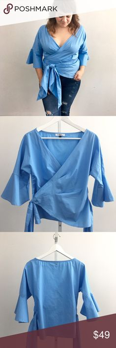 Powder Blue Wrap Blouse Lightweight wrap top with v neckline, flared statement bell sleeves, and an extra long tie at waist. Brand new. Please carefully review each photo before purchase as they are the best descriptors of the item. My price is firm. No trades. First come, first served. Thank you! :) Tops