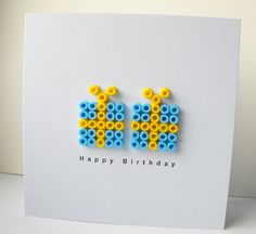 handmade birthday card ... clean and simple ... white with blue and yellow ... two graphic look presents made of beads ... luv it!!