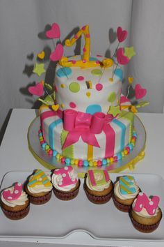 Birthday cake for a little girl I like the idea of using cupcakes for the name