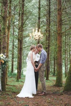 Love the chandelier addition to a forest wedding ceremony space! | Photos  by Juliet Ashley