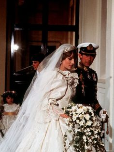 July 29, 1981:  Lady Diana Spencer marries Prince Charles at St. Paul's Cathedral in London. The Newlyweds arriving at Buckingham Palace.