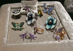 Sicis, an Italian company specializing in mosaics, and micromosaic in jeweled flowers and butterflies.  From The Gem Standard