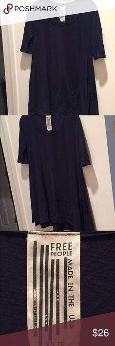 Reduced Shipping! Free People black flowing tunic Free People Black stylish & comfy cotton tunic flowing longer on right side. Pre-worn / Loved. Perfect over jeans, leggings a long skirt or bathing suit. Slightly faded - reflected in price. Fun! Note: sizes states XSJP but it's seems larger. Free People Tops Tunics