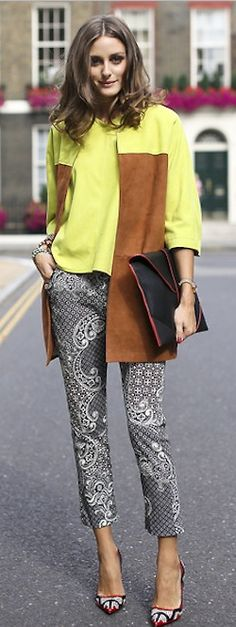 Who made Olivia Palermo's print pants, black clutch handbag, print pumps, and yellow jacket?