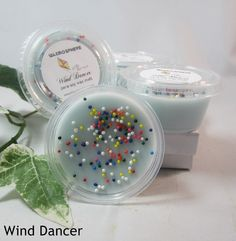 Wind Dancer: Amber, cranberry, mandarin, black currant, cocoa with peach, rose, lily and violet, ending with earthy Prairie Silver Sage. Top is decorated with colorful nonpareils.  www.Waxmosphere.com