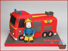 My gorgeous Nephew's 1st Birthday Cake. He loves Fireman Sam so the cake design was easy!! A large Vanilla Sponge cake shaped and decorated to resemble Jupiter and a hand modelled sugar Fireman Sam.