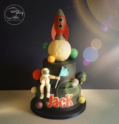 "Jack is mad about space. He asked for a cake with a rocket and an astronaut, but other than that I was given free reign with the design… and I have wanted to make a space cake for AGES, so I really went to town! 8"" of chocolate cake, 6"" of vanilla..."
