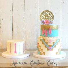 Wild One tribal inspired birthday cake with feathers, dream catcher, arrows and matching smash cake.  Turquoise, gold, pink, lavender