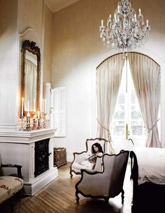 French style bedroom~love the large lounging chairs in front of the grated fireplace