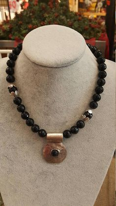 1 strand faceted cut black agate beads with silver colored metal pendant. ABOUT Jewelry Designer of Emotional Dreams offers an exciting collection, designed and handmade by designer herself. You will find a selection of rich gemstone designs. We hope that you will enjoy wearing our